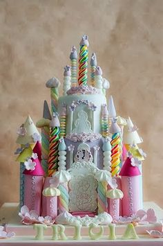 Rainbow Castle cake - For all your cake decorating supplies, please visit craftcompany.co.uk