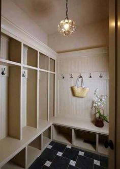 Built In Mudroom Storage I like the hooks for coats on one wall and asked for backpacks on the other wall