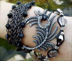 'Rhinestone peaock feather leather wrap bracelet ' is going up for auction at 12pm Fri, Jun 8 with a starting bid of $50.