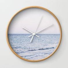 """Sensation Wall Clock by ARTbyJWP via Society6 #wallclock #clock #beachdecor #walldeco #homedecor -- Available in natural wood, black or white frames, our 10"""" diameter unique Wall Clocks feature a high-impact plexiglass crystal face and a backside hook for easy hanging. Choose black or white hands to match your wall clock frame and art design choice. Clock sits 1.75"""" deep and requires 1 AA battery (not included)."""