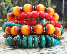 Kathmandu Charm Bracelet: Tibetan-Inspired Turquoise, Yellow, Red and Bronze Charm Bracelet $175