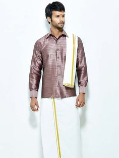Enticing light wine color raw silk shirt paired with white color cotton dhoti and angavastram. Item Code : SCU13501-3 http://www.bharatplaza.com/new-arrivals/south-indian-mens-wear.html