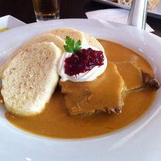 Svíčková na smetaně = Beef sirloin drowned in vegetable-based gravy with dumplings, cranberries, cream, and slice of lemon. #CzechFood