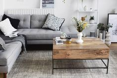 Stylish monochrome and grey living room inspiration with greenery and wood accents