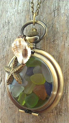 Island Time Upcycled Pocket Watch Necklace Filled with Caribbean Sea Glass, this would look nice with small shells too. Seashell Jewelry, Seashell Necklace, Shell Necklaces, Sea Glass Jewelry, Sea Glass Crafts, Sea Glass Art, Old Watches, Pocket Watches, Pocket Watch Necklace