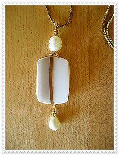 I made this pendant from a dove grey Pyrex cup shard with 18K gold plated wire and freshwater cultured pearls - Evie '14