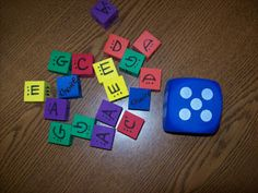 "Music: a composition game where you roll a numbered dice for an assigned note value, and a colored dice for the note name (a, g, c, etc.) This should help students work on rhythm and note recognition.  ""O For Tuna Orff: Compose Yourself with Boomwhackers!"""