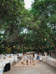 I like this set up with the long table then all the circle ones after the dance floor!