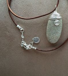 Check out this item in my Etsy shop https://www.etsy.com/listing/229542729/petoskey-stone-wire-wrapped-necklace