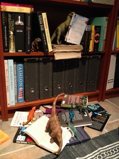 Trouble in the bookshelf. Just destroying. #dinovember