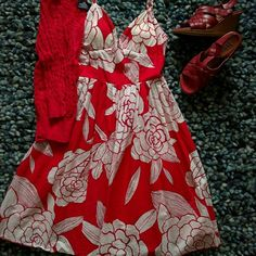 Lady In Red! Floral Dress Really fun cotton dress with a retro fit. Fitted on the top with a fuller skirt. The cups are lined and slightly padded so can be worn without a bra. Braided straps add another fun detail. Zipper back and lined with red satiny fabric. Worn once. **shoes featured are also listed for sale Y apparel Dresses