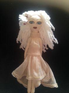 A personal favorite from my Etsy shop https://www.etsy.com/listing/223357479/handmade-felt-doll