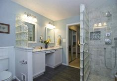 His and Hers sinks with standing shower and toilet area