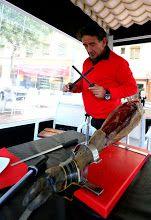 Star cortador de jamones Florencio 'Flores' Sanchidrián sharping his knives before cutting a ham on the terrace of his restaurante El Matadero in Madrid.  Photo by Gerry Dawes©2014.