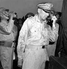 General Douglas MacArthur broadcasts to Filipinos hours after returning. Sergio Osmeno, President, drinks from canteen, 10/31/44