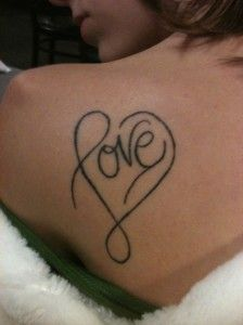 L that is a heart. if i were to get another tattoo i would probably get a little one of these on my wrist