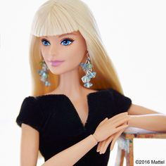 Style tip: statement earrings are the perfect way to dress up your favorite black top. #barbie #barbiestyle