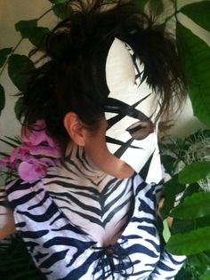 Partial zebra body paint for Elevate by Cyndi McKnight with Cyndi's Faces.