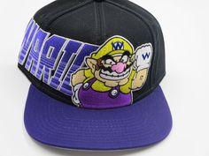 12314160e4498 Nintendo NES Wario Purple Racer Bioworld Snapback Hat. Super Mario BrosSnapback  HatsNintendoSnapback ...