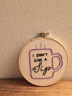 this is a custom made embroidered hoop with a personal design created by randi. the hoop reads i dont give a sip with the text inside a coffee mug.   || a b o u t t h e p r o d u c t ||  - 4 wooden hoop - hand-stitched - canvas fabric - black, purple and grey thread   || p e r f e c t f o r ||  - home decor - gift   || c u s t o m i z e ||  - custom orders always available!   || s h o w s o m e l o v e ||  - click on the <3 icon and save as a favorite! - add to cart to purchase your own…