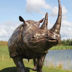 Sculptured in a charging position, our life-sized rhino captures the true element of the fearsome animal. Length - 2.7m Height - 2.15m Width 1.1m Weight 150kg