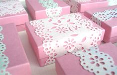 ...fill them with some yummy treats and then wrap a length of paper lace around the box and secure it neatly on the bottom with some double-sided tape.