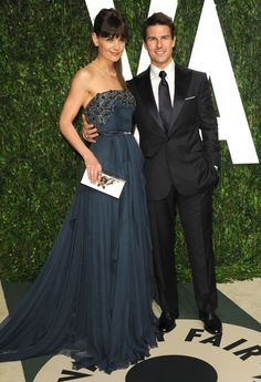 Beginning of the End - Tom Cruise and Katie Holmes' last red carpet appearance as a couple was at the 2012 Academy Awards. Both stars looked stunning, of course. They hadn't been photographed together since the February show when they announced the end of their 5-year relationship in late June. Cruise's rep confirmed that his wife filed the paperwork.