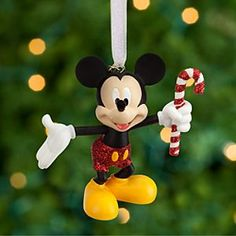 Disney Mickey Mouse Sketchbook Ornament   Disney StoreMickey Mouse Sketchbook Ornament - Mickey makes merry for the holidays with this fully sculptured figural ornament frosted in glittering red pants and candy cane stripes!