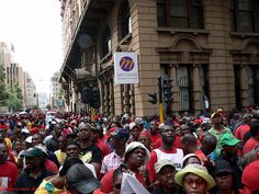 Awethu! Power!    Tens of thousands of South Africans marched peacefully through their main cities 2011-03-07 to demand Government to do more for the poor. Here's the Johannesburg crowd in Simmonds and Fox Streets as they try to get closer to the action.    About 50 000 people marched in Johannesburg. Smaller crowds turned out in Cape Town and other cities and towns for protests called by the Congress of South African Trade Unions (Cosatu), a close ally of the ANC.