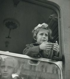 Werner Bischof    Girl at the train window    Budapest, Hungary, 1947