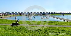 Landscape view of people enjoying the facilities at Hove Lagoon, an outdoor leisure center located in Brighton and Hove, East Sussex, England.