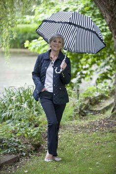 Quilted jacket, navy trousers, and embroidered spot short-sleeved merino jumper, all Viyella, Tenterden     Umbrella, Spice, Cranbrook