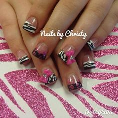 Black, white, pink, zebra and leopard French tip with bow nail design.