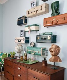 Old Suitcases...re-purposed into funky wall shelves!!   Picture only for inspiration.