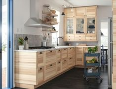 Either the price is one of the things you have to keep in mind, or not, there are enough IKEA kitchen design ideas here to inspire you into getting exactly what you want for your new or remodeled kitchen. We have found interesting takes on how you can redesign your kitchen with IKEA furniture and details, and how you can get them personalized for you to get a kitchen that feels more yours than something out of a catalog. Go ahead and take a look at the outstanding ideas we put together for you. Ikea Kitchen Design, Ikea Kitchen Cabinets, Modern Kitchen Design, Wood Cabinets, Ikea Kitchens, Banquette Ikea, Dark Wooden Floor, Ikea Home, White Countertops