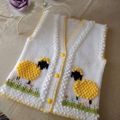 Tunus İşi Fıstıklı Kuzu Desenli Çocuk Yeleği Tarifi. 2 .3 yaş » By hatice5 Baby Knitting Patterns, Baby Cardigan Knitting Pattern, Crochet Square Patterns, Crochet Designs, Baby Patterns, Embroidery Patterns, Knit Baby Dress, Crochet Tote, Baby Vest