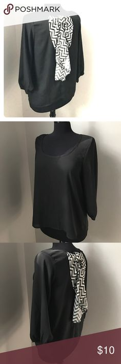 Rue 21 Black Top with Bow - L Super cute top by Rue 21 is a size large and has 3/4 sleeves. This black top has a cute black and white striped bow on the back. This scooped neck top has elastic around the edges of the sleeves. Ready to ship from a non smoking home. Rue21 Tops Blouses