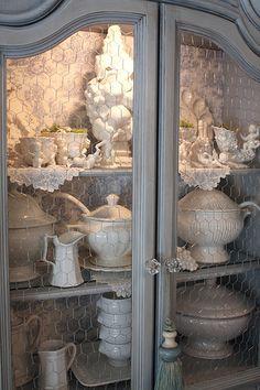 gray cabinet, chicken wire