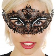 Metal Masquerade Mask with Clear Crystals. Filigree masquerade mask, black decorated with sparkling clear crystals.