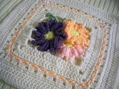 Wildflowers - Crochet Granny Square Blanket - The afghan is made of thirty-five 8.5 inch squares.