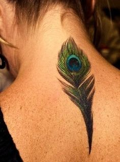 peacock tattoo- odd placement, but beautifully done.