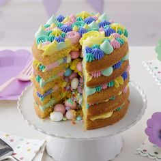 What is more exciting than cutting into a cake and having candy and sprinkles tumble out? Eating it all, of course! This colorful springtime cake will surprise your guests, and be the hit of your Easter sweet table.