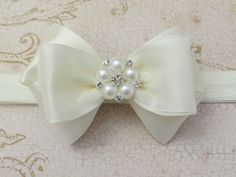 Satin and Pearls Hair Bow Clip from Pink Bowtique - Comes in custom sizes (smaller or larger) and features chiffon covered satin with a pearl cluster center stone. Flower Girl Headbands, Baby Hair Bows, Ribbon Hair, Ribbon Bows, Ribbons, Fabric Bows, Fabric Flowers, Bow Hair Clips, Bow Clip