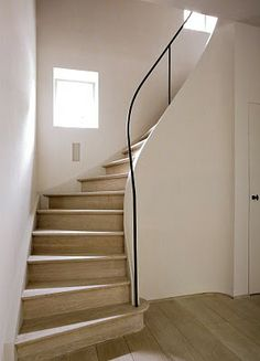 Love these stairs, but practically I would never live in a home with them because the irregularity of them would mean more falls than usual!
