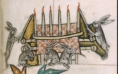 An example of the upsidedown world of many marginalia. Hares conduct a funeral. Gorleston Psalter.