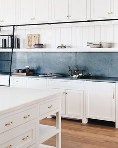 Check out this latest reveal of such a gorgeous kitchen! Library ladder in the kitchen + slate countertop and backsplash + white cabinets with brass hardware Kitchen Dining, Kitchen Decor, Kitchen Cabinets, White Cabinets, Beautiful Kitchens, Cool Kitchens, Dream Kitchens, Slate Countertop, Soapstone Countertops