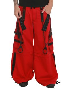 Red pants with black contrast stitching, black straps and black hardware, chains and handcuffs. Zips off to shorts.