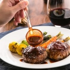 Homemade Japanese hamburger steak recipe that melts in your mouth, served with a red wine reduction sauce.