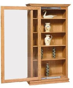 Amish Sliding Door Large Bookcase This elegant bookcase is spacious and sturdy, handcrafted with solid wood. Keep books and keepsakes protected from dust with a lovely sliding door. Sliding Door Bookcase, Sliding Glass Door, Sliding Doors, Large Bookcase, Bookcase Storage, Amish Furniture, Door Furniture, Secret Storage, Hidden Storage