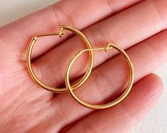 These hoops are perfect for any look. Gold Hoop Earrings, Etsy Earrings, Layered Bracelets, Gold Filled Jewelry, Gold Chains, Solid Gold, Mary